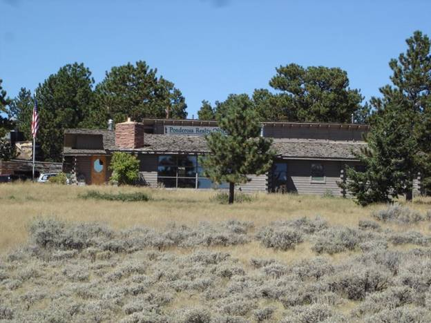 Gene and Pat Barker's former home and construction headquarters in Red Feather Lakes (1950-1980), now Ponderosa Realty