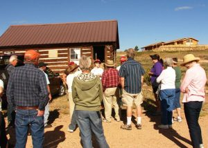 Tour participants getting info at Robinson Cabin