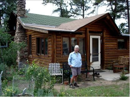"Linda Gorton in front of the old ""Pawnee"" cabin, summer of 2011"