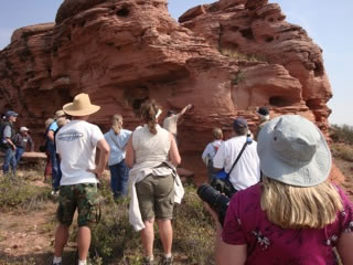 Tour Participants looking at Signature Rock at the Roberts Ranch