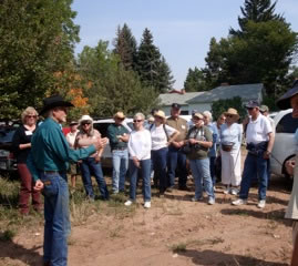 DL Roberts telling the tour group the history of the Roberts Ranch and buffalo jump on the property.