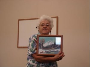 Audrey Robinson with the pictures Sugarbabe made for her.