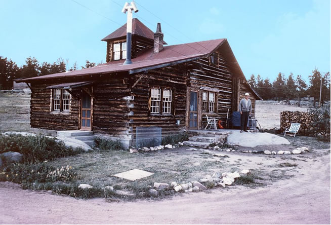 "Ray Stenzel standing in front of the ""Fox House"" at the time he purchased the Fox Acres property in 1964."