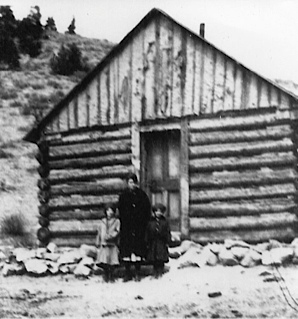 In 1908 a log school house was built in the area. Steward C. Case was one of the teachers for many years. The school is still on the original location and the original building still stands with an addition added for a private residence. Log Cabin School, where people also met for church services and Sunday school.