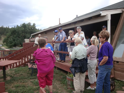 Lucille Schmitt telling the history of the Glacier View building once on the Curry Ranch now Western Ridge Restaurant owned and operated by Cheryl Franz.