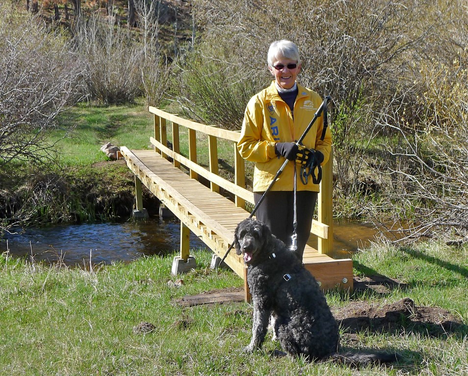 Julie Burness on the new bridge crossing South Lone Pine Creek