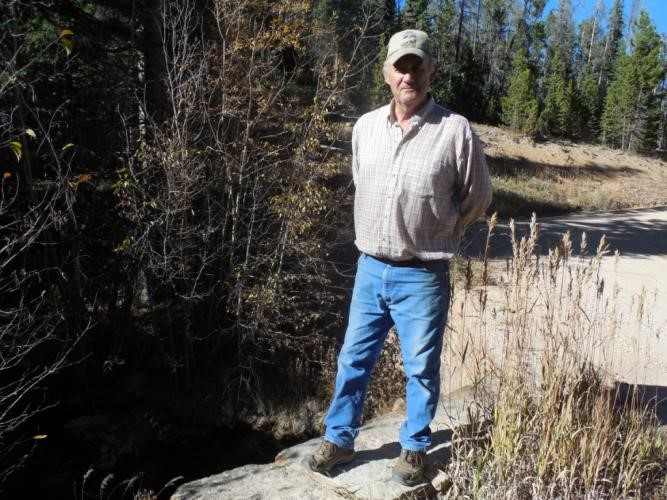 Gary Ellerman standing on the stone headwall constructed by the CCC  over the North Lone Pine Creek along the Deadman Road.